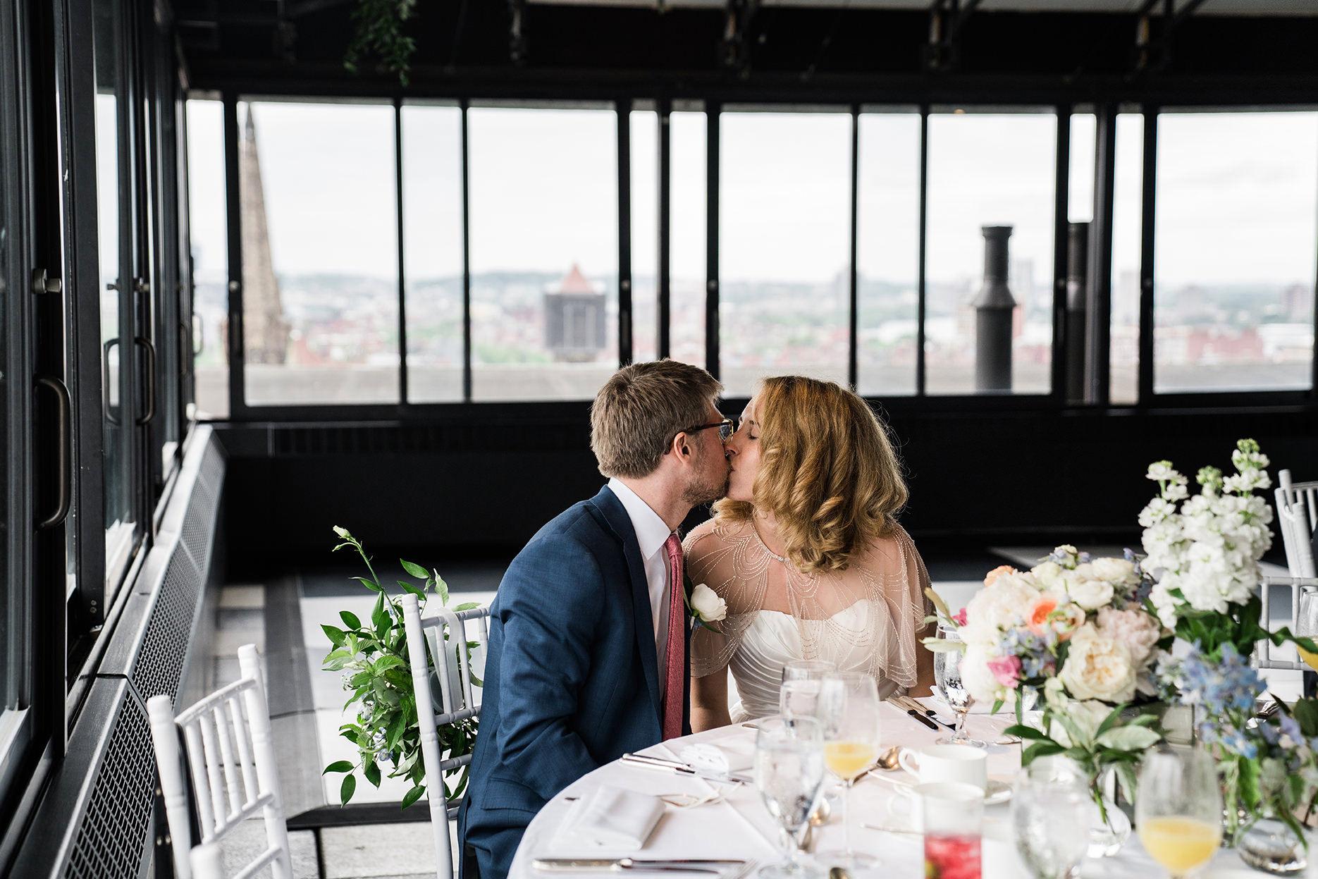 A best of Boston wedding photograph of a couple kissing their Taj Boston Rooftop wedding reception